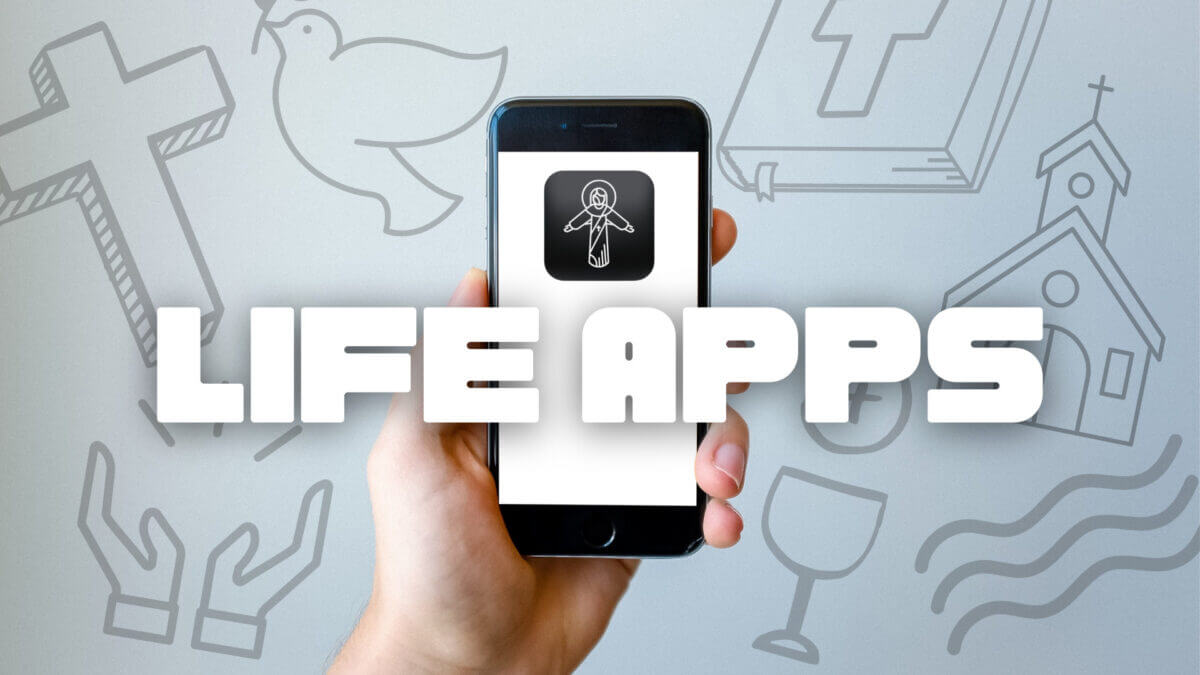 Hand holding phone with life apps on screen